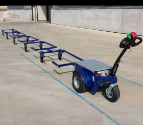 Zallys M4 electric tugger moves a tow fo carts