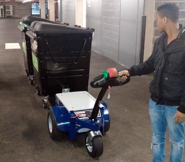 Zallys M4 electric tugger for moving waste bins in residential areas
