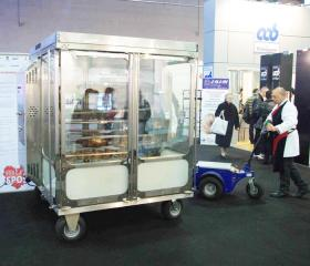 Zallys M4 electric tugger  that moves heavy catering trolleys in a fair