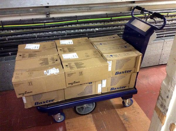 Zallys M15 electric vehicle for transporting boxes in companies