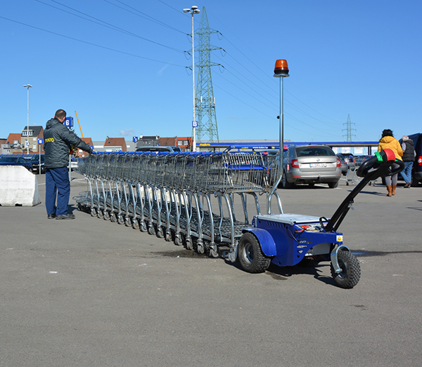 Zallys M9 electric cart pusher with remote control that moves shopping trolleys in a supermarket