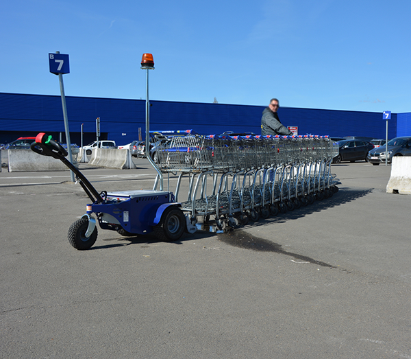 Zallys M9 electric tractor with remote control to move shopping trolleys in a mall parking lot