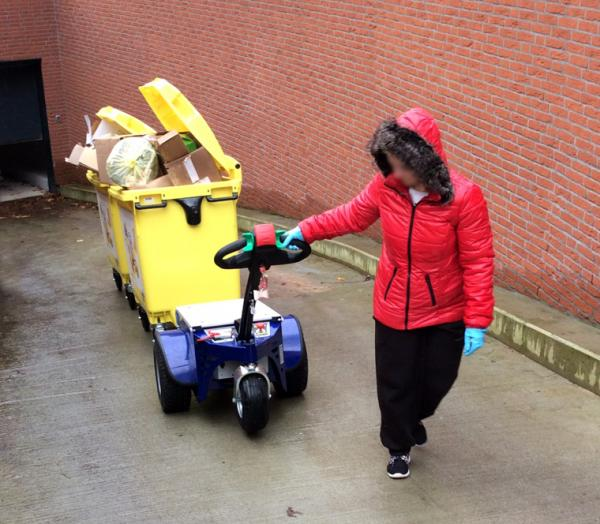 Zallys M4 electric tugger for handling waste bins on a ramp