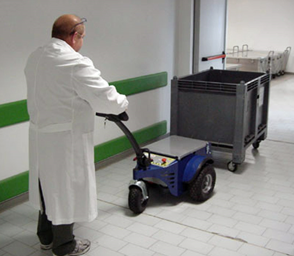 Zallys M4 electric tugger for moving wheeled trolley within hospital wards