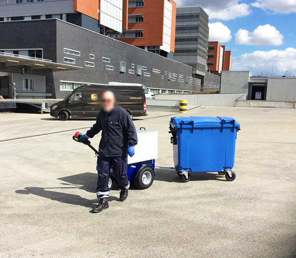 Zallys M4 electric tugger for towing wheelie bin in commercial areas