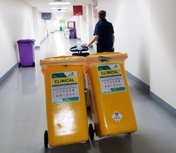 Zallys M12 battery powered tug to move waste bins in hospitals