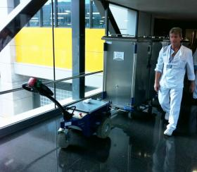 Zallys M4 electric tugger for handling food trolleys in hospitals