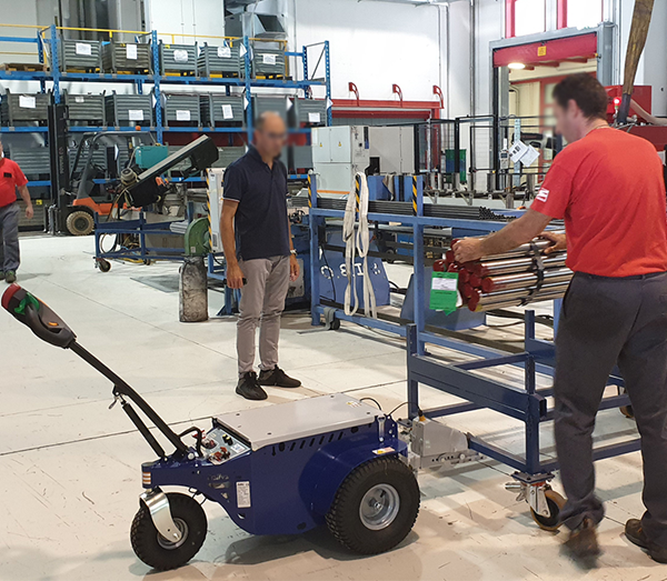 Zallys M9 electric power tug for towing trolleys in a manufacturing company