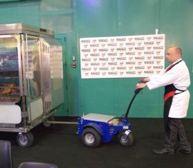 Zallys M4 electric tugger for towing heavy catering trolleys in a fair