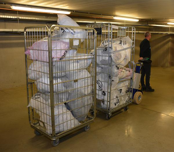 Zallys M12 electric tow tractor for handling laundry trolleys in hospitals